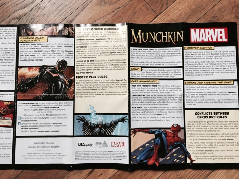 Marvel Munchkin rule book.