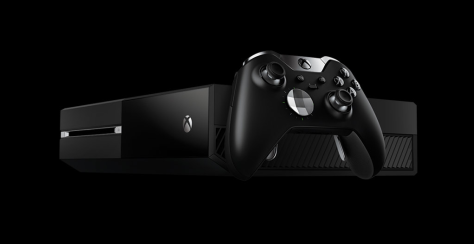 An Xbox One with a controller on the side.